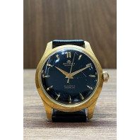 Begagnad Bucherer Incabloc 25 Jewels 18k Gold & black strap